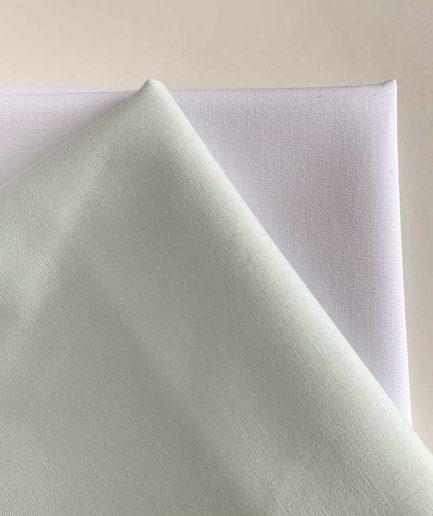 mintgroene stof katoen borduren